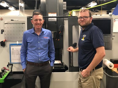 Brian Anderson, implementation specialist, ProShop USA andChris Townsend, advisor, Eagle Manufacturing, stand next to a machining center.