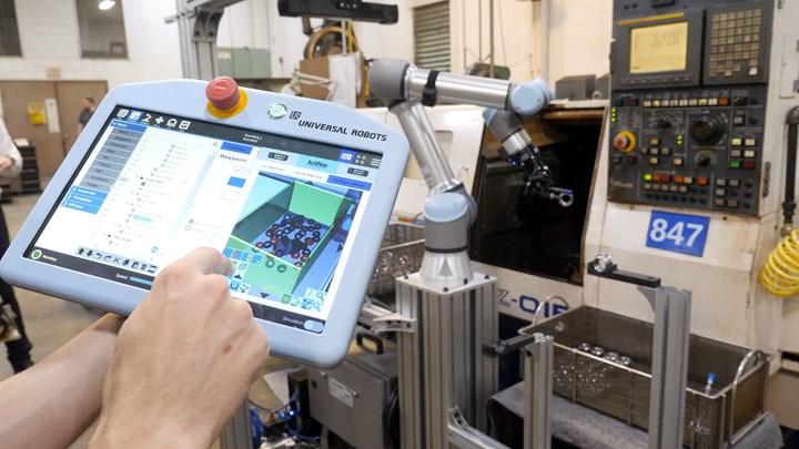 Universal Robots teach pendant for machine tending cobot