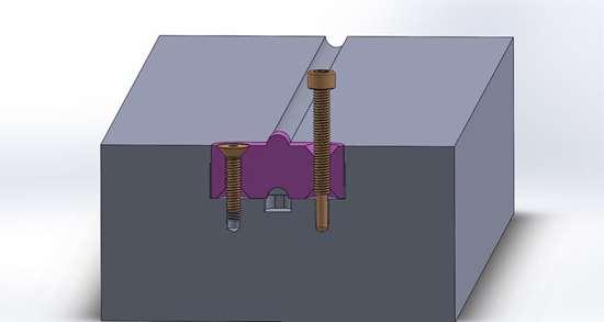 FIG 5. Un RSO de una pieza para una colada redonda. El tornillo de la derecha se usa para remover el RSO.