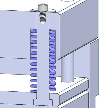 Fig. 7. Taladre y rosque las caras de dos pasadores de retorno diagonalmente opuestos para que los tornillos con arandelas puedan retener el sistema de expulsión en su posición.