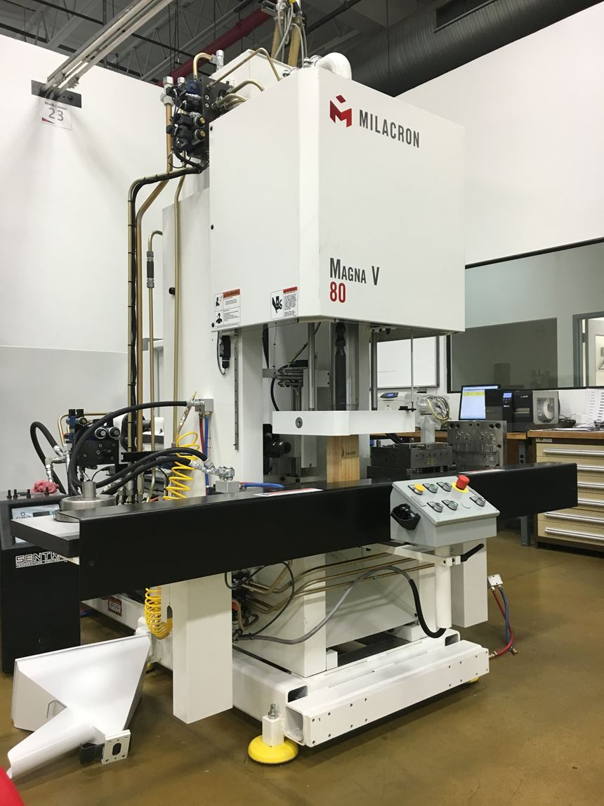 80-ton Milacron MV80 vertical injection molding machine.