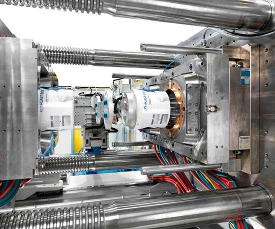 KraussMaffei GX two-platen injection molding machine with IML