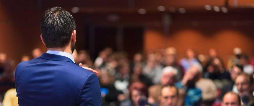 A speaker addressing a crowd