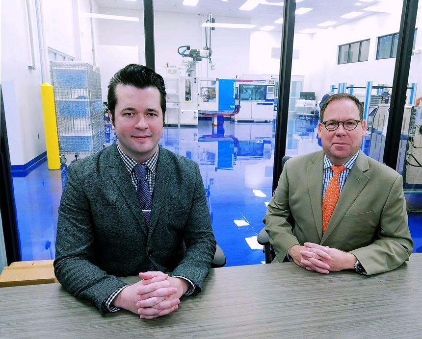 Octex Group president John W. Hoskins with Brett Wigton, chief scientist