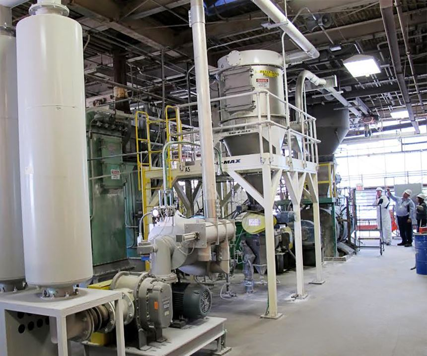 VAC-U-MAX vacuum convey system with filter separator conveying powders to weigh hoppers via 40-hp vacuum pump package.