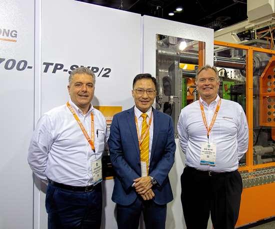 C.K. Chiang, Chen Hsong president-manufacturing, between Erik Eggen (left) and Ken Heyse of CH-America