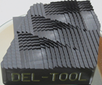 Del-Tool material machined using Poco Graphite EDM materials.