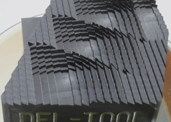 Del-Tool material machined using Poco Graphite EDM materials.