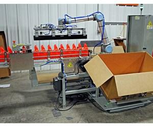Universal Robots cobot feeds product into Kanga Poucher