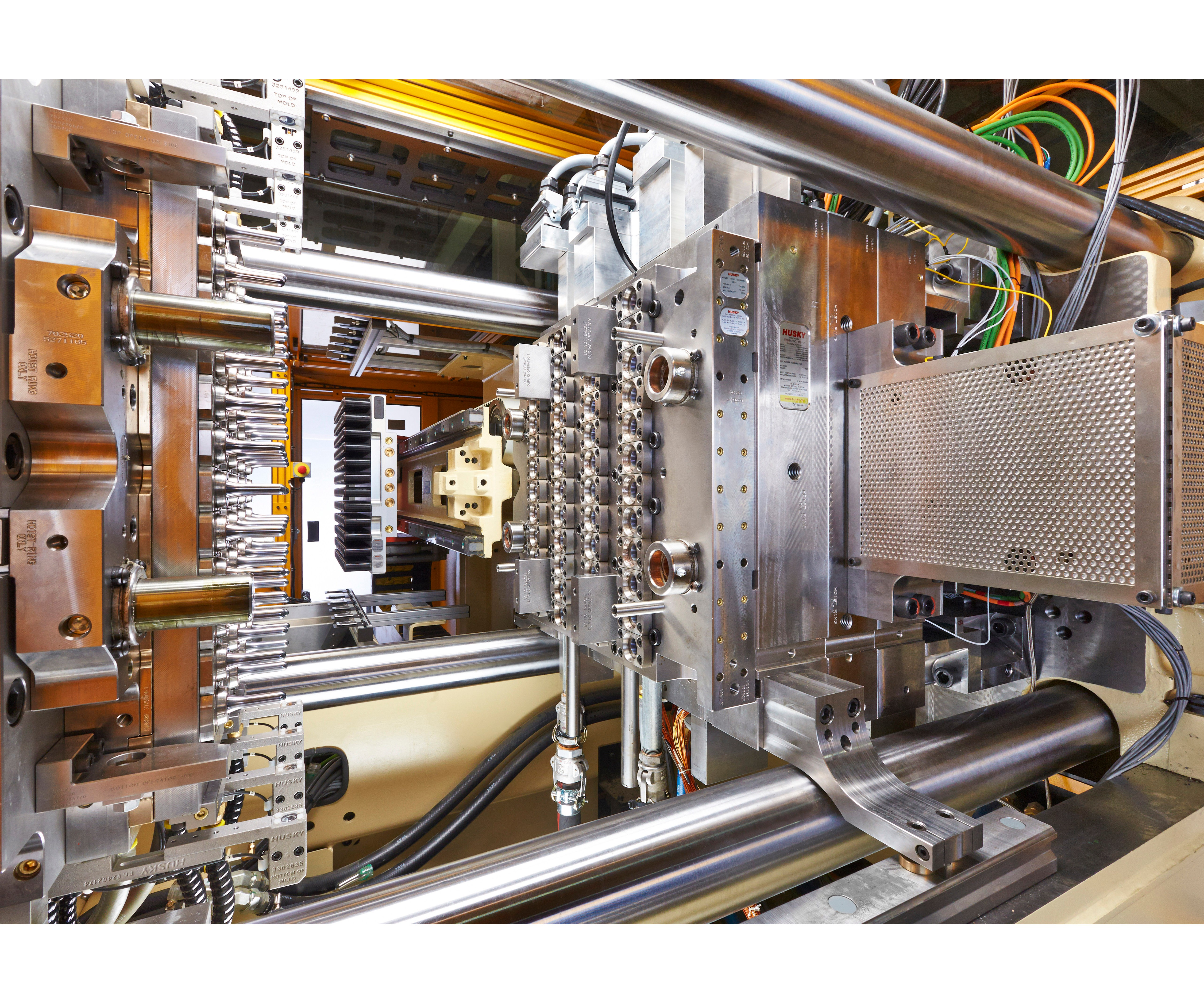 Husky shows co-injected barrier PET preforms molded on his HyPET injection molding press