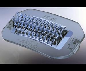 Engel injection molds LSR automotive headlamp lenses