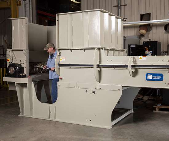 """With Republic Machine's """"Split-A-Part"""" design, the entire power frame assembly of the industrial shredder splits horizontally apart from the feed assembly frame."""