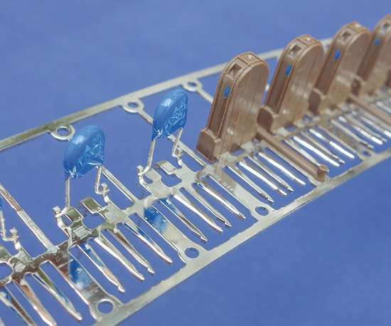 Engel supplies linear cell systems for overmolding plastic onto a metal striip  to produce electronic components.