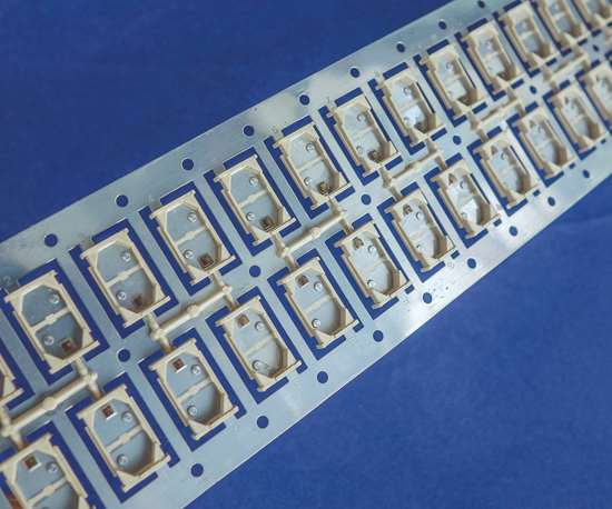 Engel offers flexibility in configuring cells for injection molding metal/plastic hybrid electronic parts.