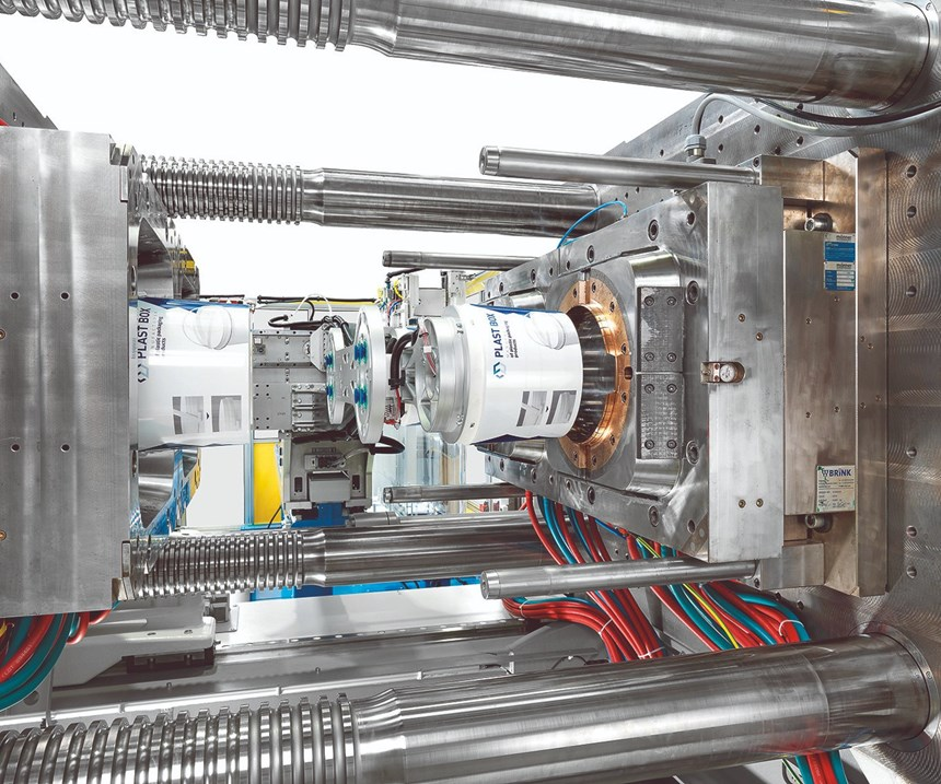 KraussMaffei GX 900 injection machine with IML automation from Campetella
