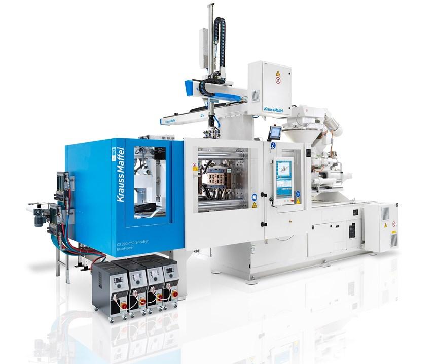 KraussMaffeiCX 200 servo-hydraulic injection moldingpress with new AZ 50 solid silicone feeder