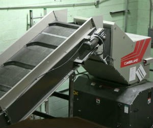 Conveyor fed granulator