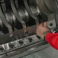 Man checks sharpness of granulator rotor knives