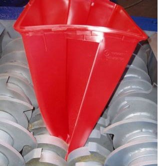Red bin being shredded in cumberland four rotor shredder configuration