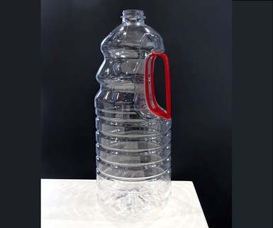 KHS introduced a PET bottle design with undercuts that take a snap-in HDPE handle.