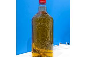 Superior bottle definition with Liquiform is exemplified in this PET liquor bottle with embossed detailing.