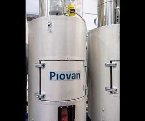 Piovan's new Modula drying hoppers with diamond-pattern steel walls.