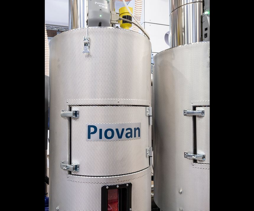 Piovan's new Moduladrying hoppers with diamond-pattern steel walls.