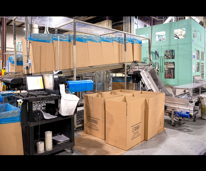 With automatic bottle packing, one person can tend four machines, like this Aoki ISBM.
