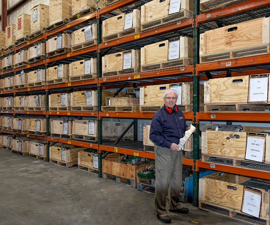 O'Leary shows off the crates that hold all tooling and change parts for a single molding job.