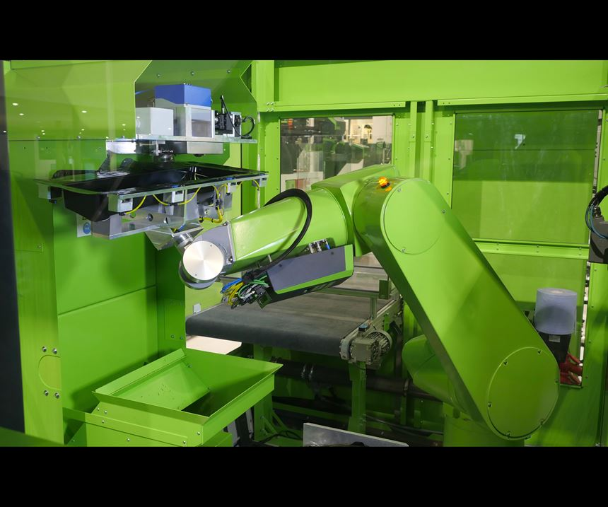 Engel's automated cell performs laser trimming of Decoject parts after molding.