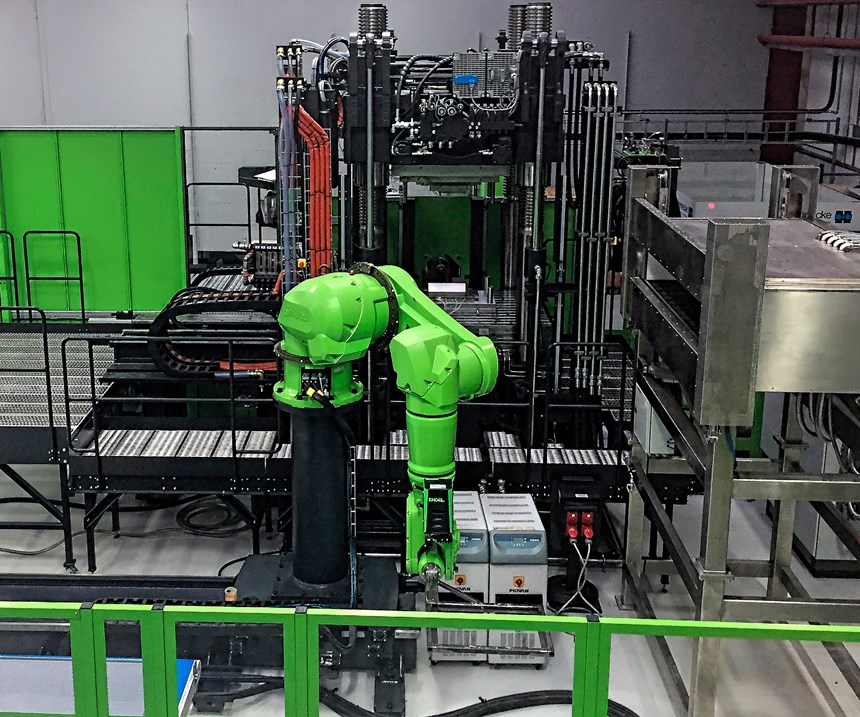 In the composite overmolding cell, a six-axis robot places organosheet blanks in an IR oven and then in the press for preforming and overmolding.