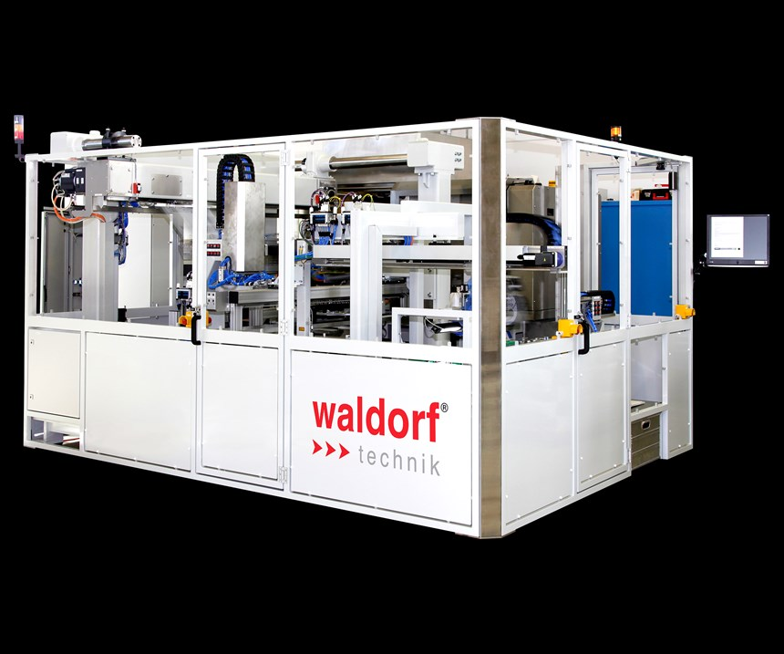 This Waldorf Technik Vario Tip FSS (floor space saving) system for demolding, inspecting and packing medical pipette tips is one-fourth the size of previous designs.