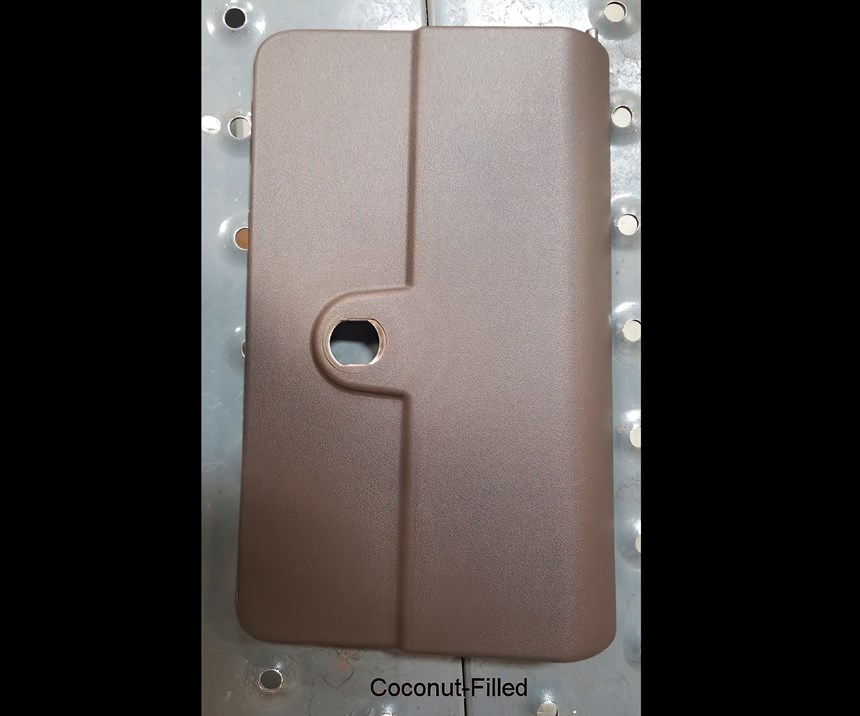 Cover in PP with coconut fiber is a test part molded for automotive and agricultural-equipment OEMs.