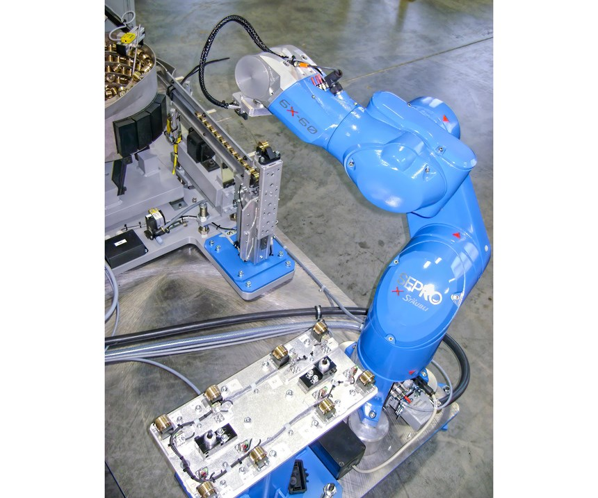 Here, a six-axis robot picks inserts from a bowl feeder and places them in a fixture for pickup by a three-axis Cartesian robot, which puts them in the mold and removes finished parts, as shown in the overall cell view.