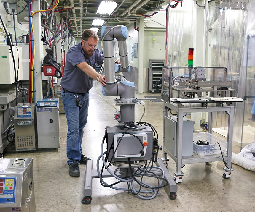 Cobots can easily be moved from press to press, as seen here at Dynamic Group.