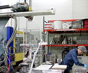 At Dynamic Group, a small injection molder in Ramsey, Minn., a Universal Robots UR10 cobot handles the entire injection molding process.