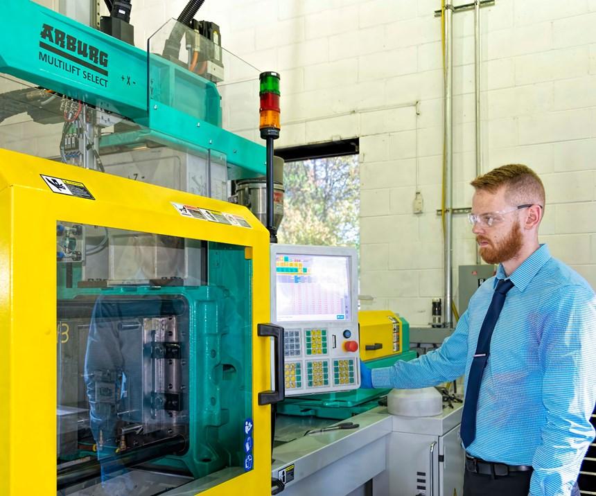 Matt Roane, process engineer, runs mold-qualification trials on a 66-ton, all-electric Arburg machine.