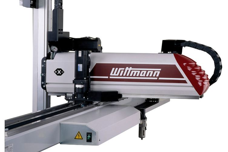 Cartesian robots save floor space by incorporating the control cabinet into the robot beam.