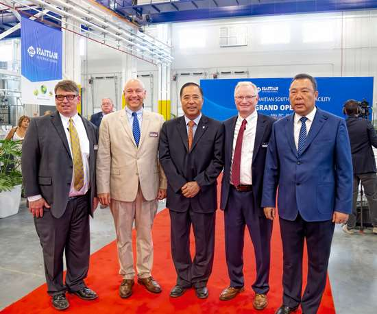 The plant opening was attended by Zhang Jianming, Haitian Group CEO (center); Zhang Jianfeng, CEO of Haitian Plastics Machinery (right); and Absolute Haitian co-owners (l.-r.) Glenn Frohring, Nathan Smith, and Mike Ortolano.