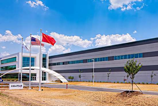 Absolute Haitian's first U.S. assembly plant for injection molding machines opened in May in Monck's Corner, S.C., near Charleston.