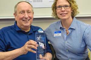 Rod Roth receiving an award from Western Washington University's Plastics & Composites Engineering Program