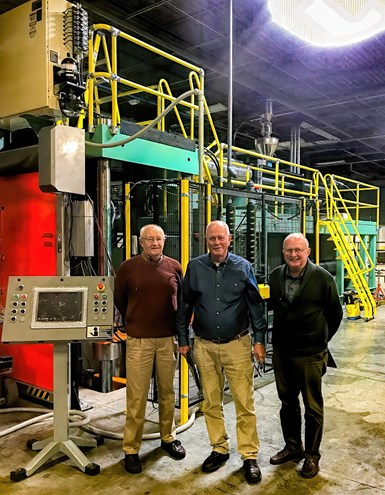 Over 100 years of experience: L. to R.: Wilmington's Ken Bealer, chief mechanical engineer; Russ La Belle, president; and John Allred, v.p. of technology, beside a new vertical press.