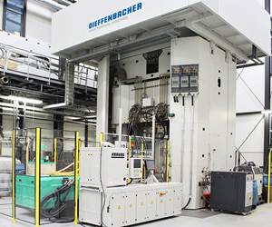 Hybrid composite molding system at Fraunhofer ICT uses components from Arburg, Dieffenbacher and others.