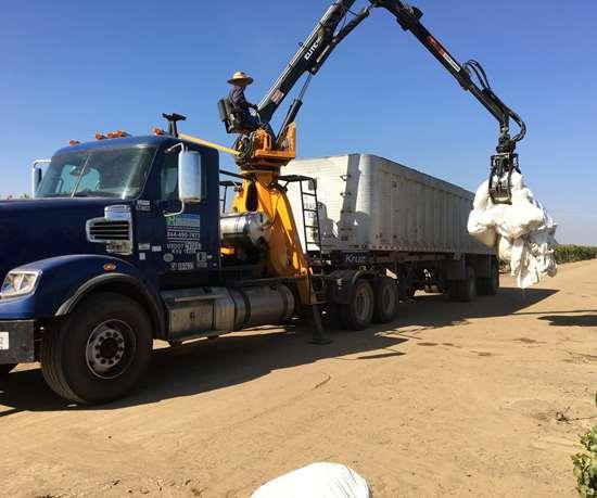 trucks gathering material