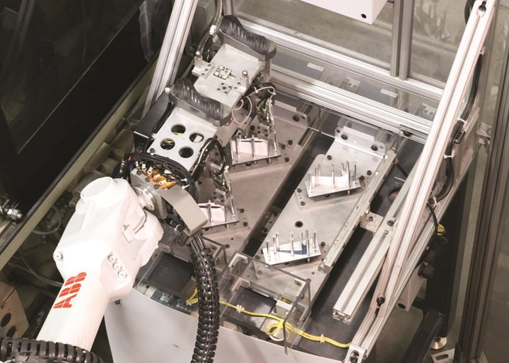 The same six-axis robot and EOAT that transfers the TPE grips from injection to blow molds also picks and places in-mold labels in the blow molds.