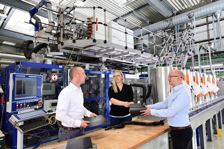 Engineering plastics experts Tilmann Sontag (l.), Loreen Winkelake and Arthur Rieb experiment with blow molding composites at the Dormagen technical center of Lanxess' HPM unit.