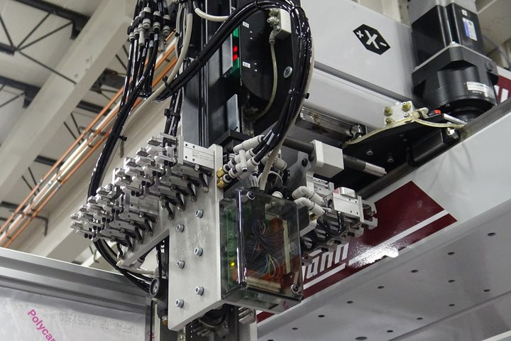 Wittmann W822 robot with micro-insert EOAT. Most insert molders with higher production runs are using horizontal injection presses with top-entry robots.