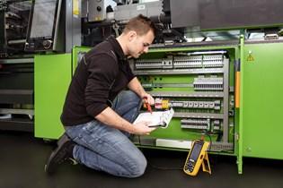 worker doing preventative maintenance