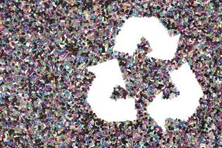recycling symbol made from post-consumer recycled plastic pellets