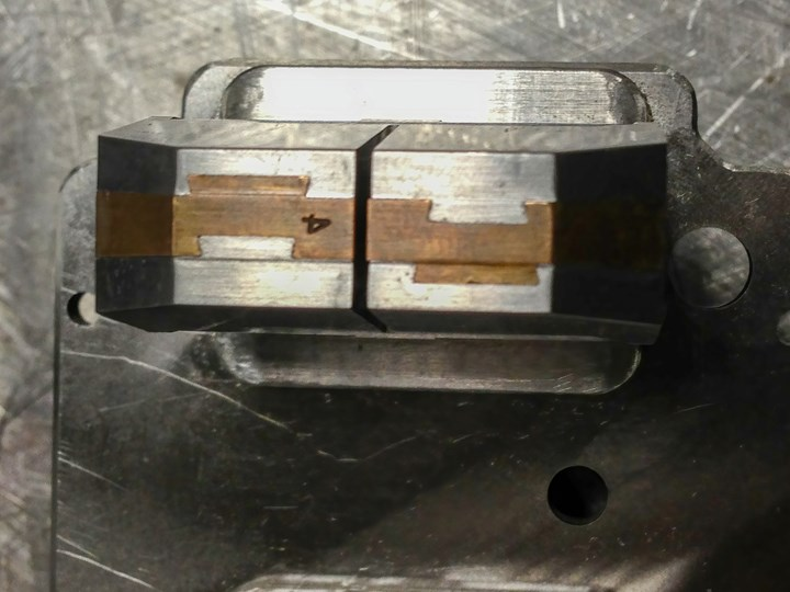A core with twin berylliumcopper dovetailed lifters.